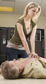 Emergency First Responder administering chest compression